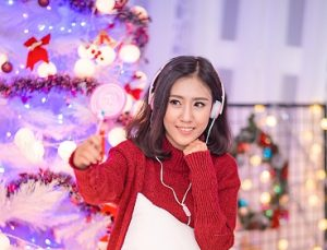 young girl in front of a Christmas decoration