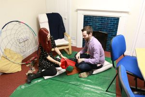 Healthcare staff member with patient in creative activity